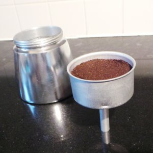 Step 3 - Fill the filter funnel with surface coffee